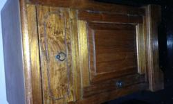 A solid teakwood cabinet table in good condition 9/10.