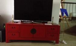 Chinese style red TV console like new. 4 drawers and 2