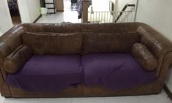 Its an used two seater sofa with 2 pillows ,2 bolsters