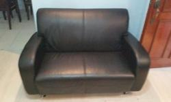 We sell two seater sofa in black. Still in good