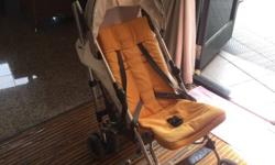 pre-loved Stroller, with rain cover. The stroller is