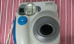 Selling Instax Mini 7S Polarid Camera. Age: 3 weeks