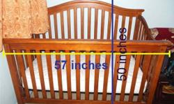 Hi, i'm selling off my USED! solid wooden baby cot for