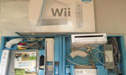 Selling used Wii console, Wii Fit board and games. All