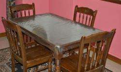 Selling of used wooden dining table with 4 chairs.