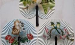 Antique folding fan. In those days, it is in black soft