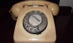 You are looking at a Vintage Beige Rotary Telephone.