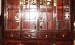 Letting go an elegant vintage display cabinet. It's