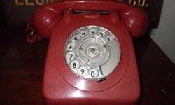 You are looking at a Vintage Red Rotary Telephone.