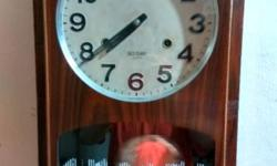 One working old wall clock for sale , in good condition