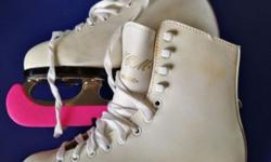 White leather ice skates (U.S. Size 4), with skate