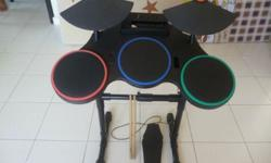 Drumset with pedal and drumsticks. Good condition. Cash