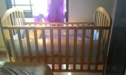 Used wooden baby cot. Good condition Dimension: