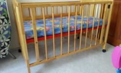 Simple wooden baby cot with mattress for sale. Only