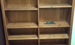 Selling a used solid wood bookcase with 6 shelves;