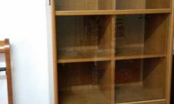 Selling a good condition wooden glass cabinet. If
