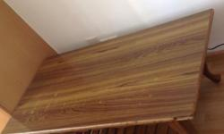 Used wooden rectangular centre table in fairly good
