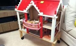 Selling a pre-loved wooden doll house, with wooden