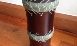 Wooden cylindrical vase with floral pattern. Condition: