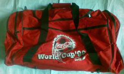 On sale here is a used once World Cup Coca~Cola Luggage