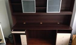 A good condition writing desk with drawers and book