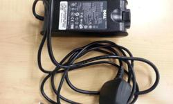 Used Dell laptop power adaptor. Output: 19.5V, 4.62A,