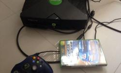 Xbox in good working condition for sale! Comes with one