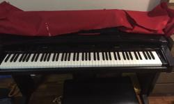 Yamaha Clavinova in good shape along with Yamaha