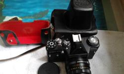 Good working condition SLR Camera with real leather bag