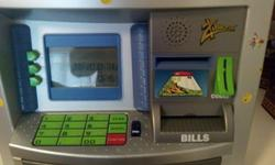 Zillionz personal ATM kids bank. Retails at around $45.